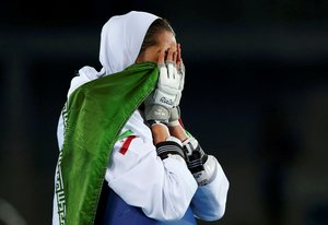 FILE PHOTO: 2016 Rio Olympics - Taekwondo - Women's -57kg Bronze Medal Finals - Carioca Arena 3 - Rio de Janeiro, Brazil - 18/08/2016. Kimia Alizadeh Zenoorin (IRI) of Iran celebrates. REUTERS/Peter Cziborra (BRAZIL - Tags: SPORT OLYMPICS SPORT TAEKWONDO) FOR EDITORIAL USE ONLY. NOT FOR SALE FOR MARKETING OR ADVERTISING CAMPAIGNS/File Photo