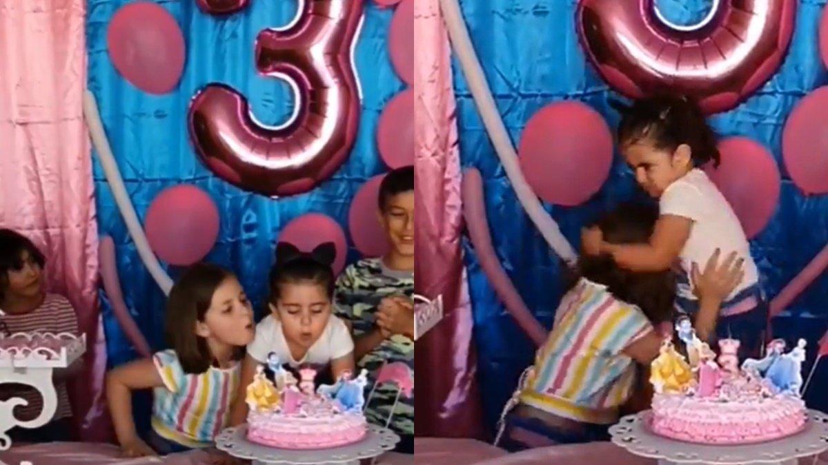 El vídeo viral de las niñas: tira de los pelos a su hermana, que sopló las velas de su tarta con siniestra cara de satisfacción
