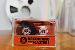 This picture taken on March 14, 2019, shows an audio cassette made with magnetic stripes in the production plant of Mulann, in Avranches, northwestern France. - Mulann products magnetic stripes for magnetic cards like bank card and for audio use like vintage audio cassette. (Photo by CHARLY TRIBALLEAU / AFP)