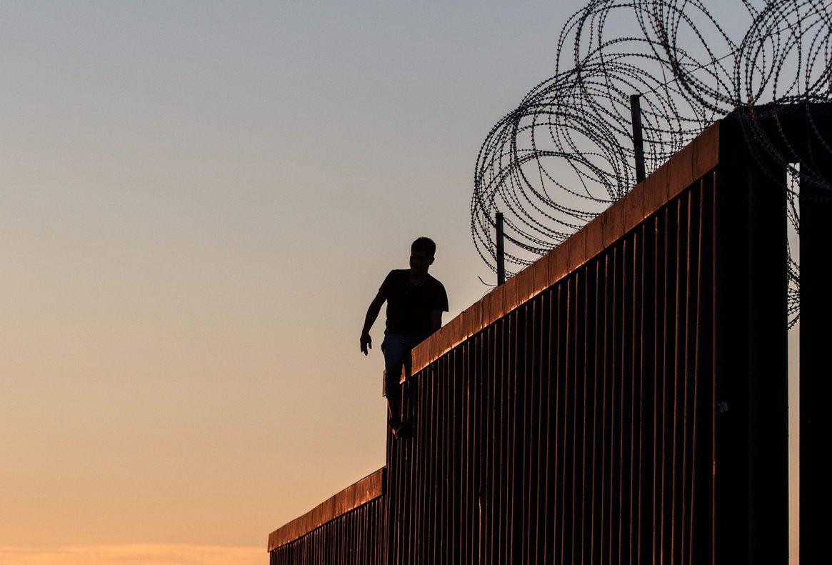 A man stands on the US-Mexico border wall for fun in Playas de Tijuananorthwestern Mexico- He camehe disruptedhe declared victory.Photo by Guillermo AriasAFP