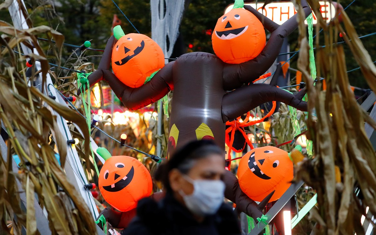 Artificial pumpkins decorations are seen ahead of Halloween at Wilmersdorfer Strasse shopping street, as the coronavirus disease (COVID-19) outbreak continues, in Berlin, Germany, October 26, 2020. REUTERS/Fabrizio Bensch