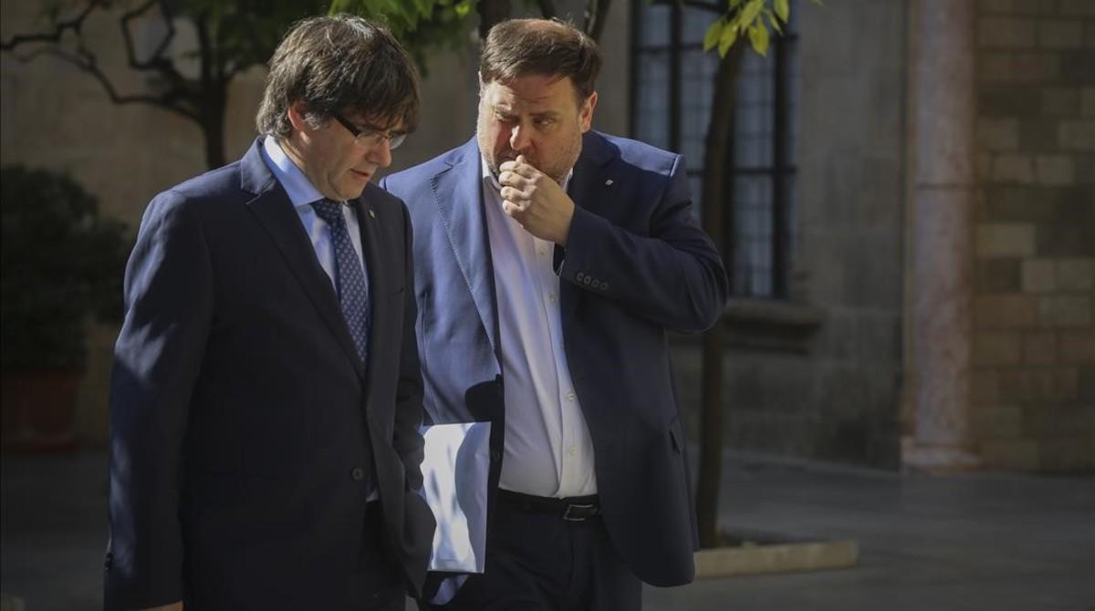 Puigdemont y Junqueras, en el Palau de la Generalitat el pasado mes de mayo.