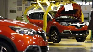 New models Renault Captur are seen during the inauguration of the production line of the new model Renault Captur in Valladolid, northern Spain on February 5, 2012. Today is also the sixtieth anniversary of the production of Renault 4CV. AFP PHOTO/ CESAR MANSO