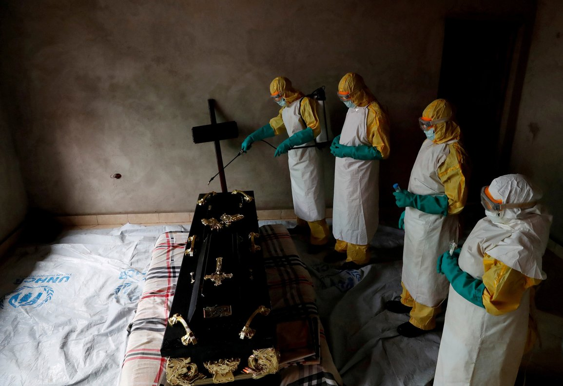 A healthcare worker sprays a room during a funeral of  a person who is suspected of dying of Ebola in Beni  North Kivu Province of Democratic Republic of Congo  REUTERS Goran Tomasevic File Photo