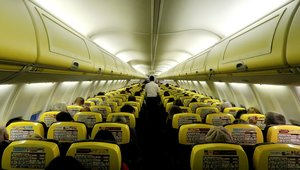 FILE PHOTO: A cabin crew member serves passengers onboard a Ryanair passenger aircraft travelling from Madrid International Airport to Bergamo Airport, Italy, January 13, 2018. Picture taken January 13, 2018. REUTERS/Stefano Rellandini/File Photo