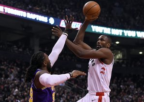 Jan 1, 2019; Toronto, Ontario, CAN; Toronto Raptors center Serge Ibaka (9) shoots for a basket over Utah Jazz forward Jae Crowder (99) in the first half at Scotiabank Arena. Mandatory Credit: Dan Hamilton-USA TODAY Sports