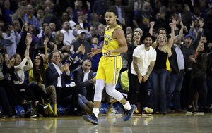 Golden State Warriors' Stephen Curry celebrates a score against the Sacramento Kings in the second half of an NBA basketball game Thursday, Feb. 21, 2019, in Oakland, Calif. (AP Photo/Ben Margot)