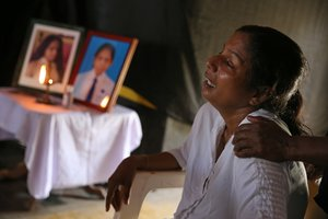 The mother of Shaini 13 who died as bomb blasts ripped through churches and luxury hotels on Easter mourns at her wake in Negombo Sri Lanka April 22 2019 REUTERS Athit Perawongmetha