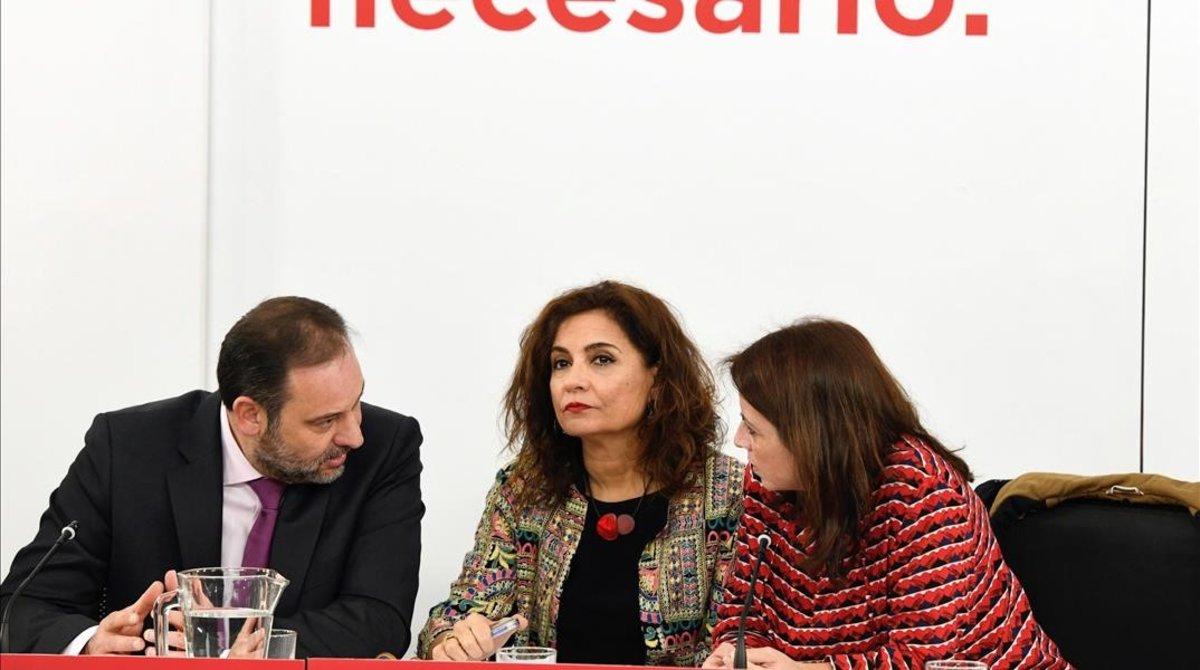 José Luis Ábalos, María Jesús Montero y Adriana Lastra, este lunes en la sede del PSOE.