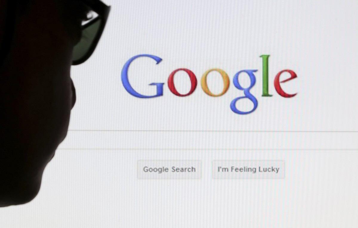 A computer user poses in front of a Google search page in this photo illustration taken in Brussels