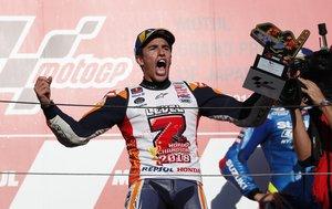 MotoGP - Japanese Grand Prix - Twin Ring Motegi, Motegi, Japan - October 21, 2018 Repsol Honda's Marc Marquez celebrates winning the MotoGP race and the MotoGP world title on the podium REUTERS/Toru Hanai