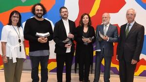 Foto de familia de los premiados, en CaixaForum.