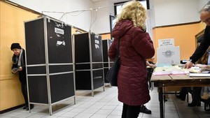 fcasals42387952 a man leaves a polling booth before to vote on march 4 2018180304141314
