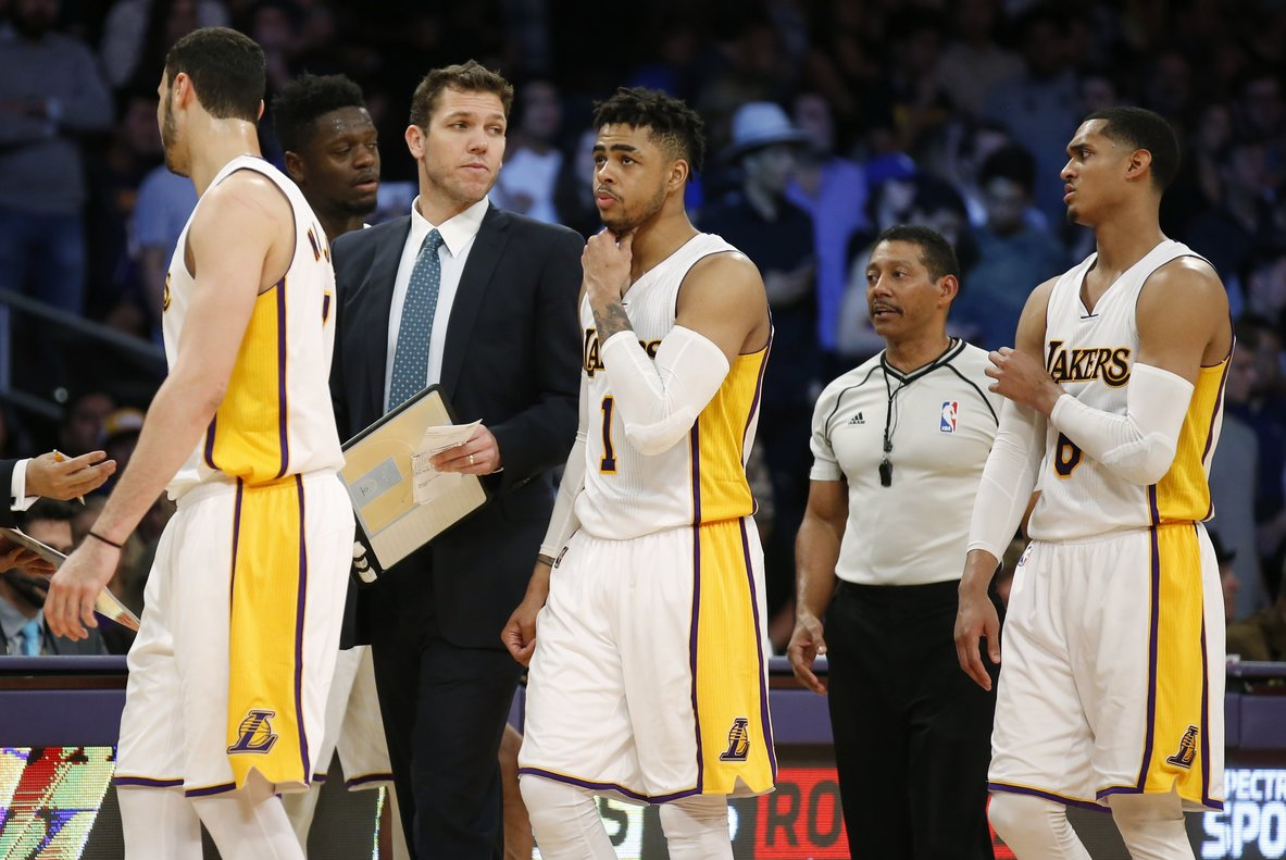 Los Angeles Lakers head coach Luke Walton third left walks with team members including from left forward Larry Nance Jr forward Julius Randle guard D Angelo Russell and guard Jordan Clarkson during the second half of an NBA basketball game Sunday March 12 2017 in Los Angeles The 76ers won 118-116 AP Photo Danny Moloshok