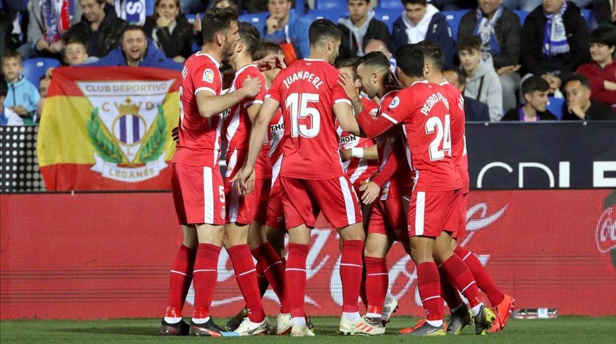 Los jugadores del Girona celebran uno de los goles de Portu en Leganés.