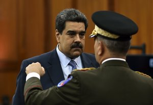 Venezuela s President Nicolas Maduro speaks with defence minister Vladimir Padrino after a press conference to warn the Lima Group that he would take energetic measures if they do not rectify their position in 48 hoursat the Miraflores presidential palace in CaracasPhoto by YURI CORTEZAFP