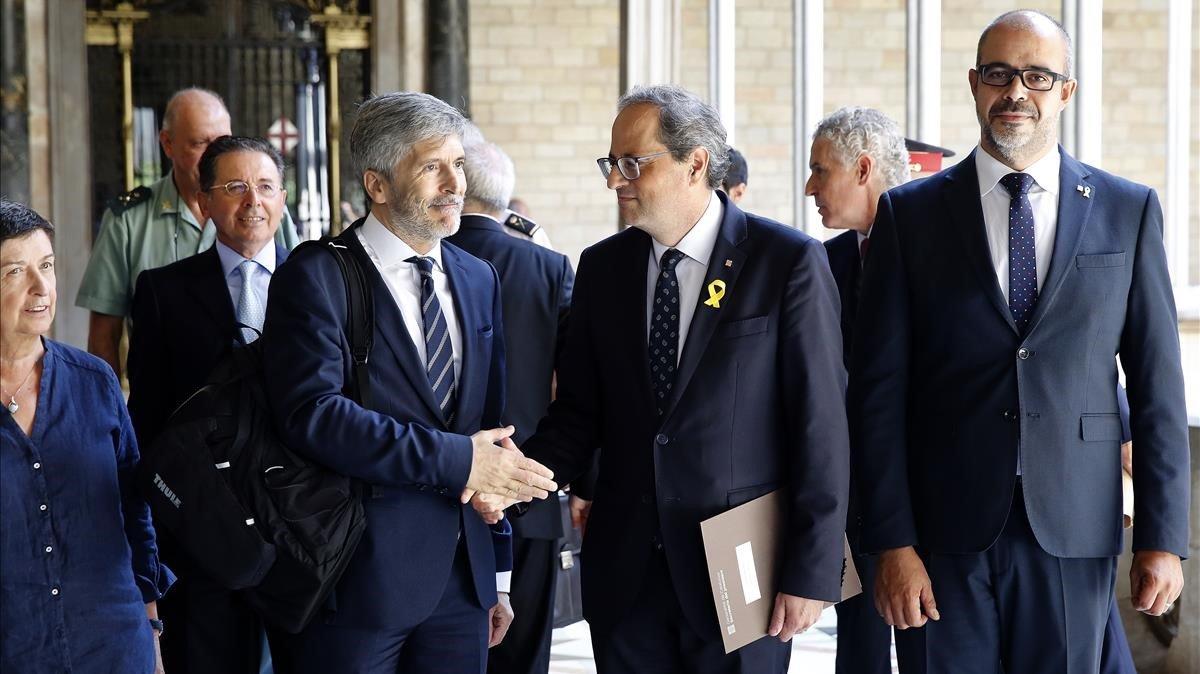 El President Torra, junto al Ministro Grande Marlaska y el Conseller Buch en la reunión de la Junta de Seguretat de Catalunya.