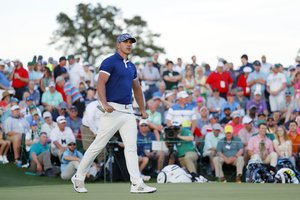 AUGUSTA, GEORGIA - APRIL 11: Brooks Koepka of the United States reacts to a missed birdie putt on the 18th green during the first round of the Masters at Augusta National Golf Club on April 11, 2019 in Augusta, Georgia. Kevin C. Cox/Getty Images/AFP