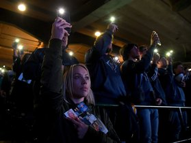 ANAHEIM, CA - FEBRUARY 10: Members of the community hold lights at the end of the memorial service honoring baseball coach John Altobelli, his wife, Keri, and their daughter Alyssa at Angel Stadium of Anaheim on February 10, 2020 in Anaheim, California. The Altobellis were traveling with former Lakers star Kobe Bryant, his 13-year-old daughter Gianna and four others when the helicopter crashed Jan. 26 in foggy conditions, killing everyone on board. Jayne Kamin-Oncea/Getty Images/AFP
