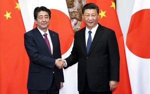 Xi Jinping, presidente de China, y Shinzo Abe, primer ministro de Japón.
