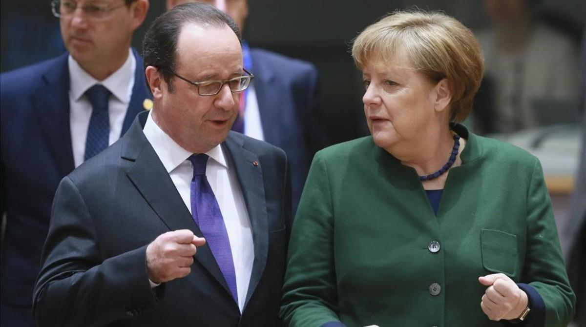François Hollande y Angela Merkel, en Bruselas, el 10 de marzo.