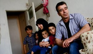 MusayMurfat, con sus cuatro hijos, en eldomicilio que viven en el barrio deAltindag, en las afueras deAnkara.