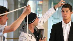 Ricardo Marques Ferrerira con Cristiano Ronaldo, en una imagen del Facebook del estilista.