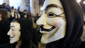 icoy18148149 a protester wearing a guy fawkes mask symbolic of the hackt160623200035