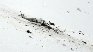icoy37022270 the wreckage of an helicopter lies in the snow after crashin170124155512