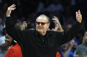 Actor Jack Nicholson waves as the crowd cheers when the scoreboard reads Happy Birthday Jack Nicholson, today is his 75th birthday, during the Los Angeles Lakers and the Oklahoma City Thunder NBA basketball game in Los Angeles, Sunday, April 22, 2012. The Lakers won 114-106 in double overtime. (AP Photo/Reed Saxon)