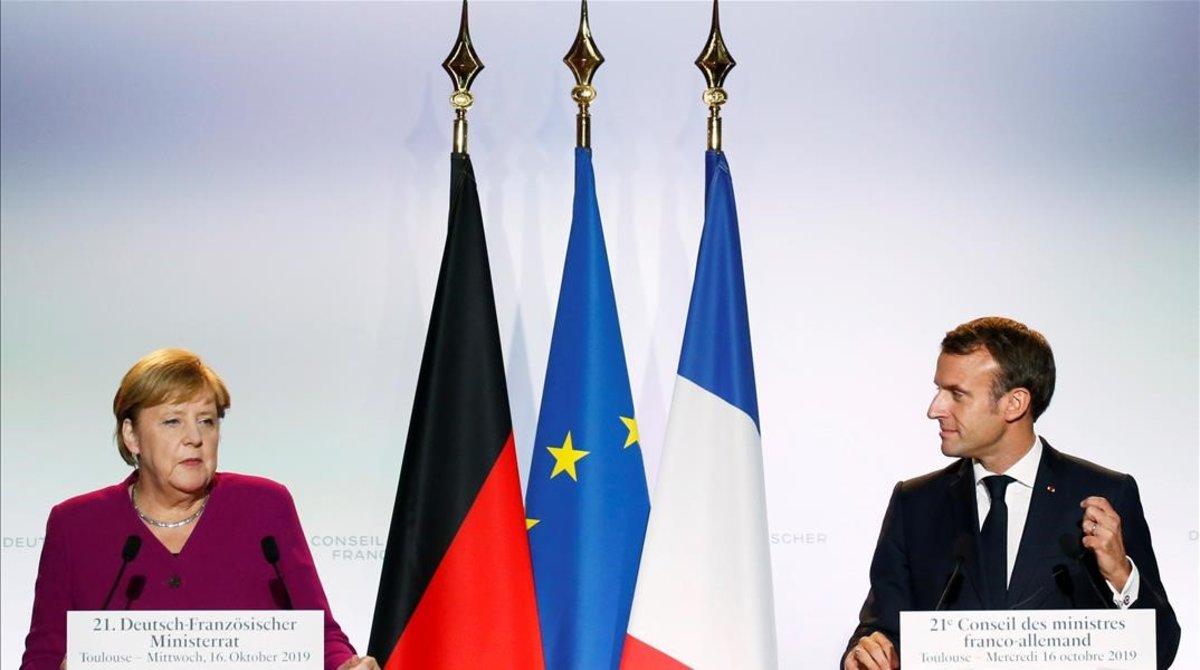 Merkel y Macron, en la rueda de prensa posterior a la cumbre francoalemana, el pasado 16 de octubre, en Toulouse.