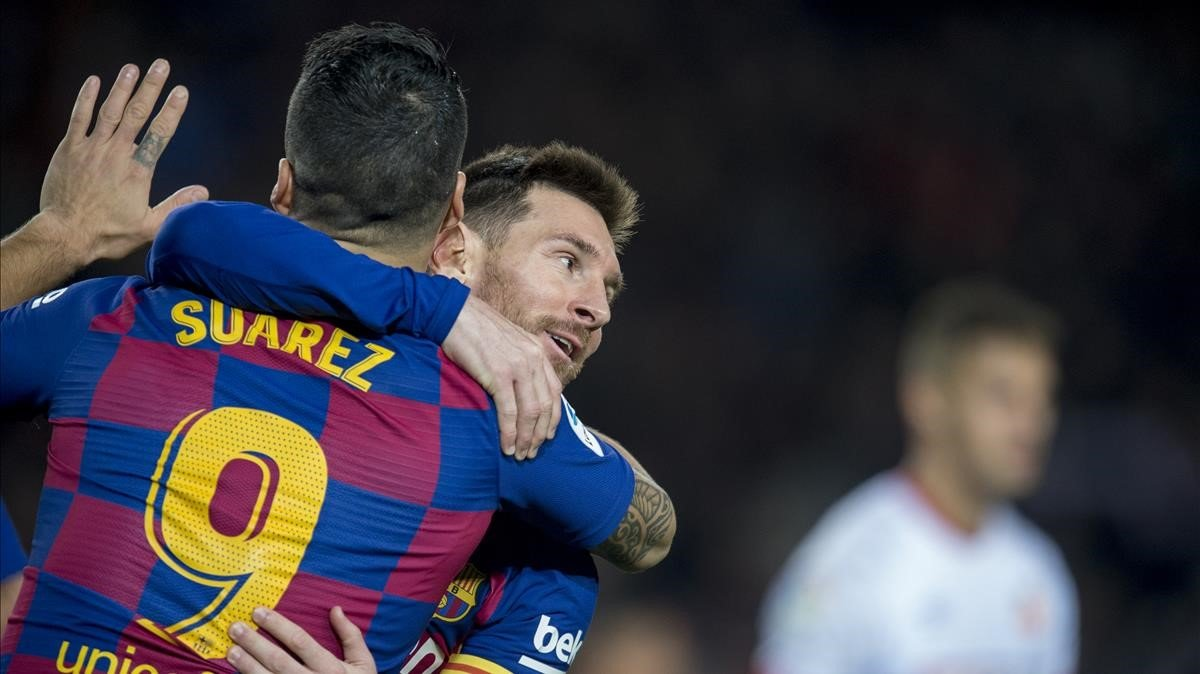 Messi y Suárez festejan un gol del Barça en el Camp Nou.