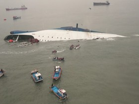 South Korean ferry Sewol is seen sinking in the sea off Jindo April 16, 2014, in this picture provided by Korea Coast Guard and released by Yonhap. Almost 300 people were missing after a ferry sank off South Korea on Wednesday, the coastguard said, in what could be the countrys biggest peacetime disaster in nearly 20 years. REUTERS/Korea Coast Guard/Yonhap