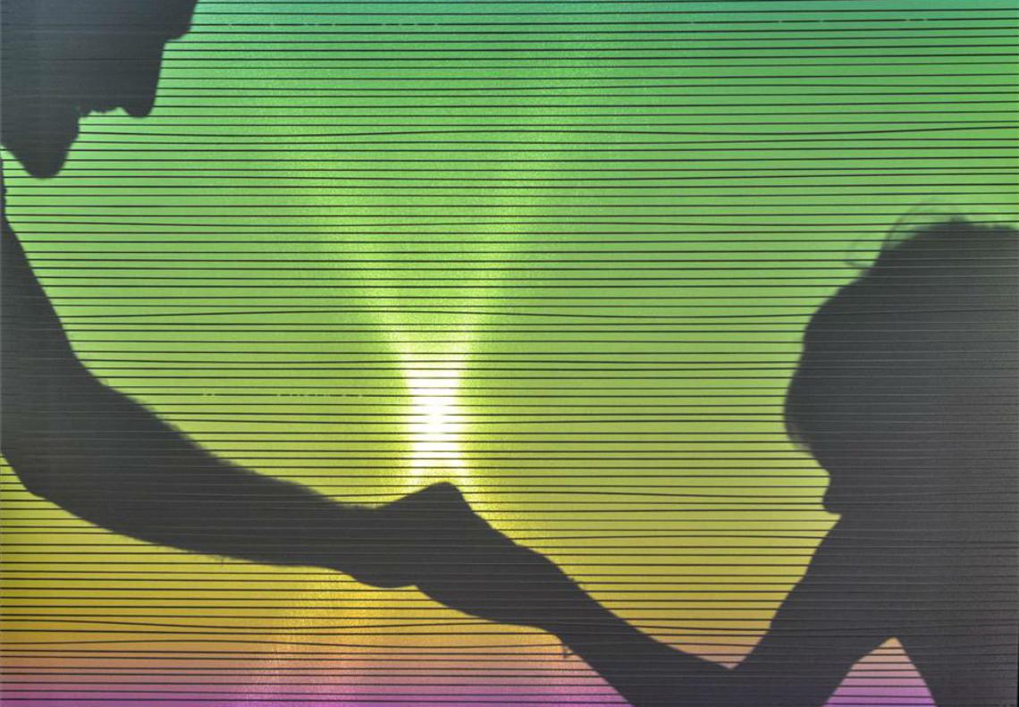 Dos personas palpan una canción en el aparato diseñado en el Sónar+D.