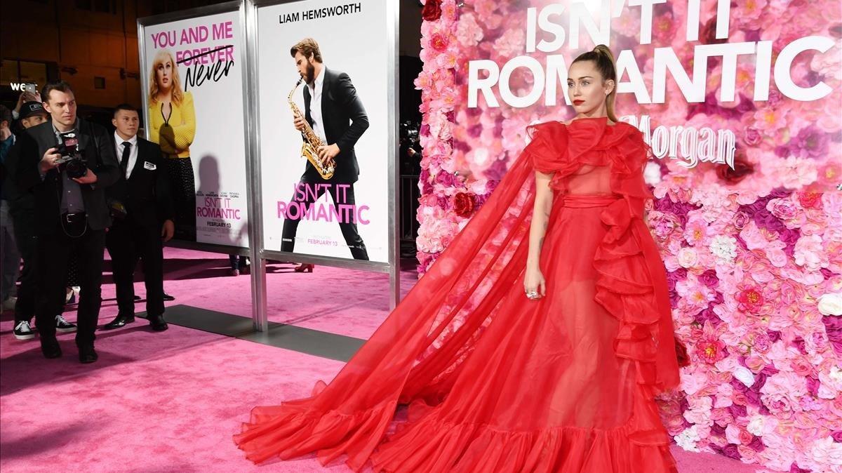 Miley Cyrus, posando para las cámaras en lapremierede la película.