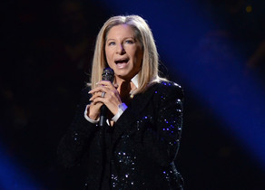 FILE - In this Oct. 11, 2012, file photo, singer Barbra Streisand performs at the Barclays Center in the Brooklyn borough of New York. Streisand will take the stage at the Tony Awards on June 12, 2016. The singer and actress, who was a Tony nominee in 1962 for I Can Get It for You Wholesale and in 1964 for Funny Girl, hasnt graced Tony night since 1970, when she got a special Tony. (Photo by Evan Agostini/Invision/AP, File)