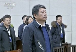China s former deputy intelligence chief Ma Jian appears in a courtroom in the northeastern port city of Dalian  China  The court said Ma Jian has been found guilty of crimes including accepting bribes and insider trading.  CCTV via AP