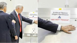 Mike Pence coloca su mano en un equipo de la NASA a pesar de la advertencia No tocar.