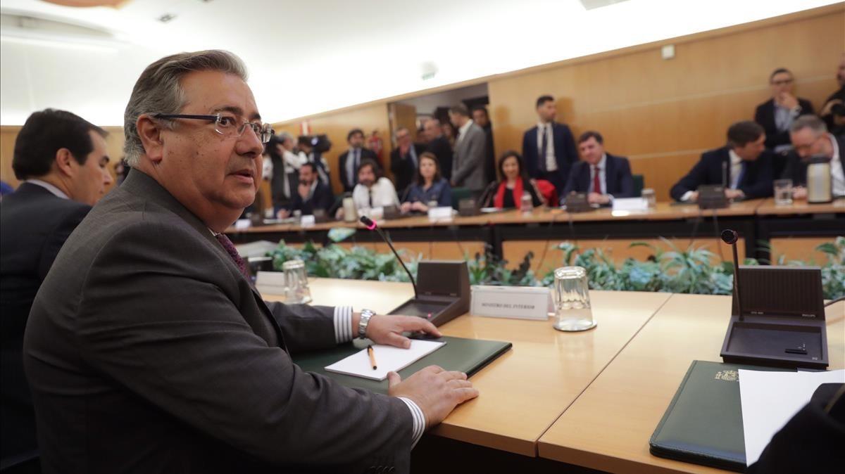 El ministro del Interior, Juan Ignacio Zoido, y el Secretario de Estado de Seguridad, José Antonio Nieto, durante la reunión informativa con partidos políticos.