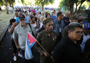 People stand in line to pay tribute to Cubas late President Fidel Castro in Revolution Square in Havana