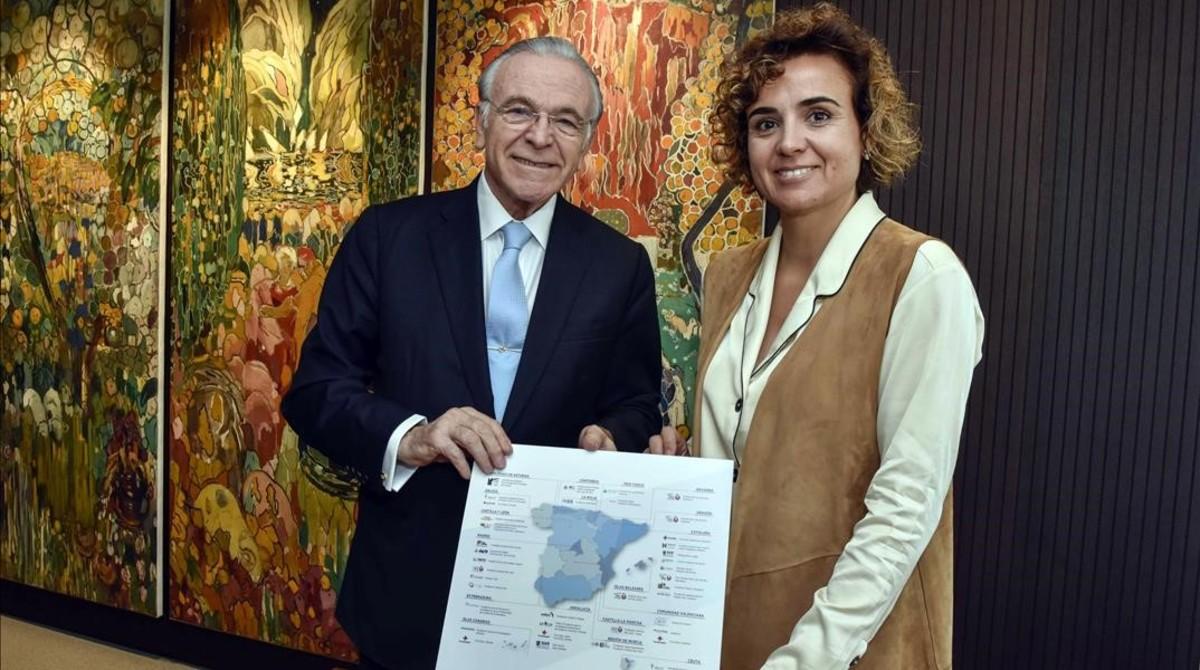 Isidro Faine y Dolors Montserrat firman un acuerdo para impulsar la atencion a los enfermos avanzados