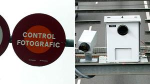 Señal de aviso de un semáforo con control fotográfico y un radar en una avenida de Barcelona.