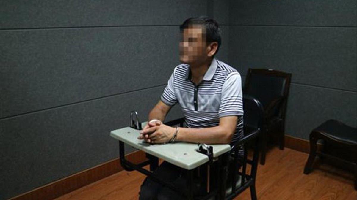 El escritor chino Liu Yongbiao, detenido, en una imagen facilitada por la policía de Zhejinag.